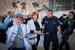 Lesley Sachs and Rachel Cohen Yeshurun, of Women of the Wall, being detained by police officer at the Kotel. Rosh Chodesh Kislev 5773 (Nov. 15, 2012).